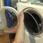 fitting-the-front-retaining-band-to-Aeg-washing-machine