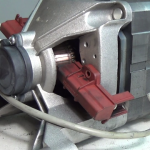 Fitted-washing-machine-motor-carbon-brushes-in-a-Indesco-welling-motors