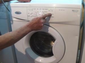 Press RESET button 4 times on Whirlpool Washing Machine