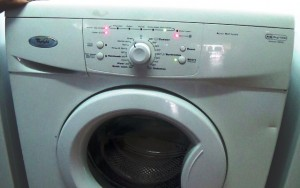 Test mode sequence initiates flashing lights appear on Whirlpool washing machine
