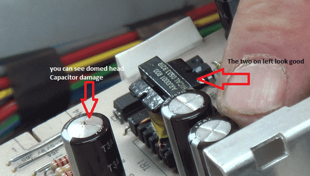 Washing machine starts then stops or turns off, blown capacitors